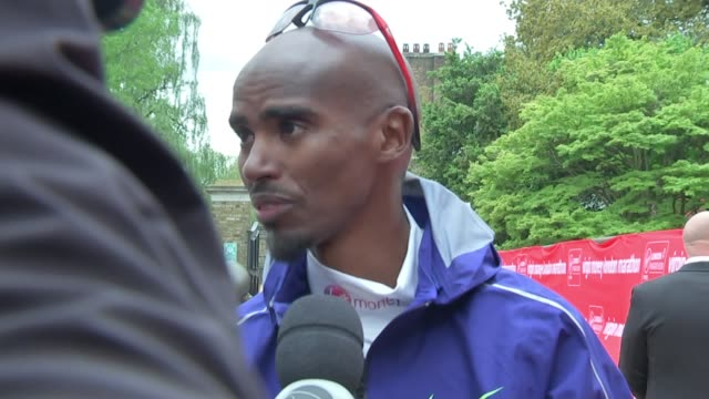 eliud kipchoge first man to win race four times with fastest ever london time england london ext sir mo farah interview sot - london marathon stock videos & royalty-free footage