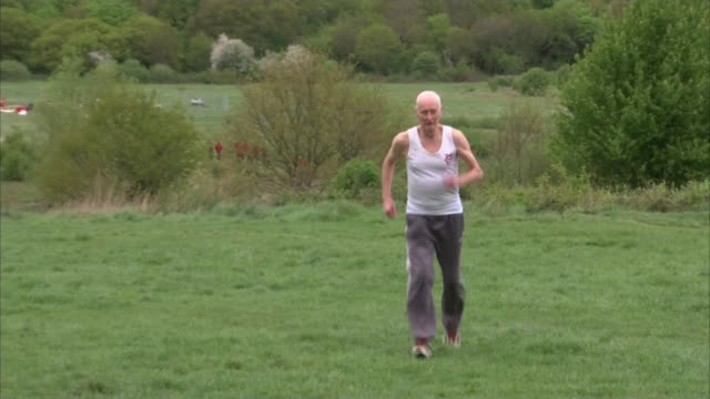 ken jones to run 39th london marathon england london chingford ext ken jones running ken jones interview sot - london marathon stock videos & royalty-free footage