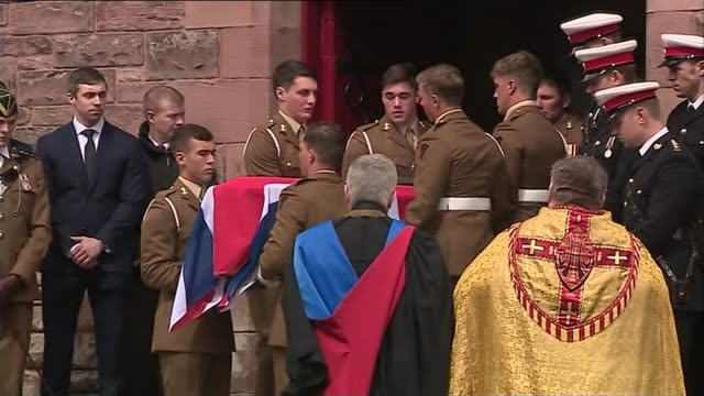 family and friends raise thousands for charity lib / 050516 scotland dunfermline ext flagdraped coffin of david seath being carried out of church by... - dunfermline stock videos & royalty-free footage
