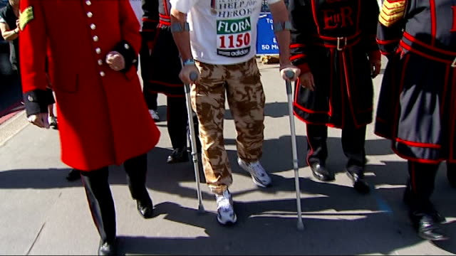 stockvideo's en b-roll-footage met major phil packer passes halfway stage england london tower bridge ext major phil packer walking on crutches with beefeaters and chelsea pensioners... - yeomen warder