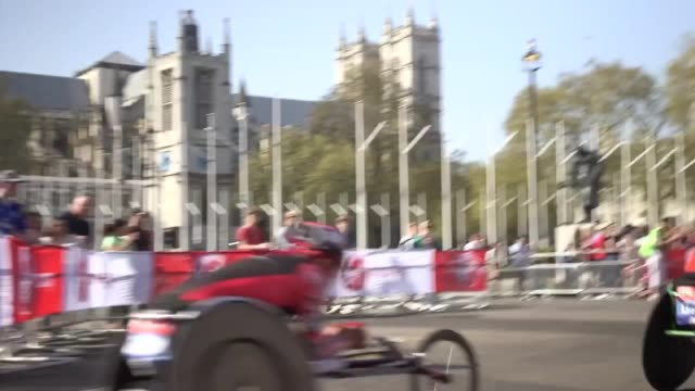 london marathon men's wheelchair competitors pass through the westminster section of the route also footage of marshals and onlookers - track and field event stock videos and b-roll footage