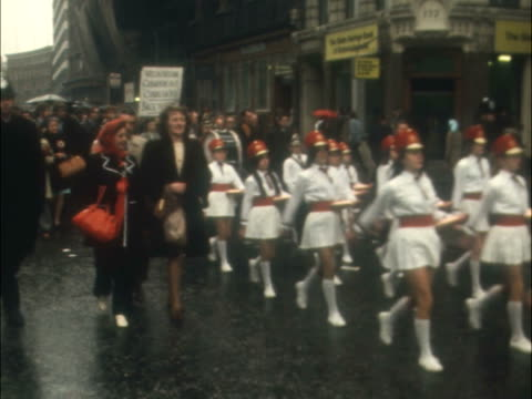 "london march to commons by miners; london march to commons by miners; england: london: house of commons: march l-r led by drum majorettes: sof: ""we... - megaphone stock videos & royalty-free footage"