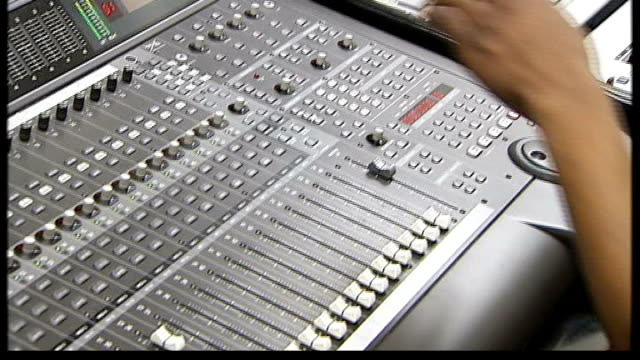 london mayor aide suspended after corruption allegations int people working in recording studio of black music project code 7 audio level meter on... - audio software stock videos & royalty-free footage
