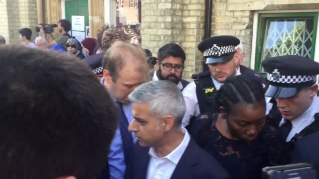London Mayor Sadiq Khan is confronted by upset locals outside Notting Hill Methodist Church near Grenfell Tower in west London where a fire engulfed...