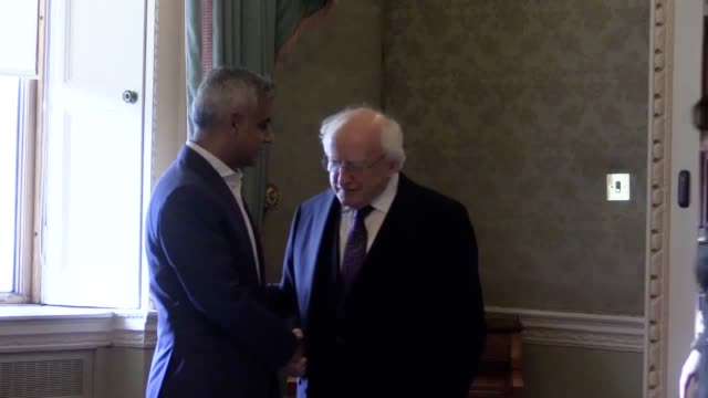 london mayor sadiq khan signs the visitor book alongside president michael d higgins at aras an uachtarain in phoenix park dublin and arrives for a... - michael d. higgins stock videos and b-roll footage
