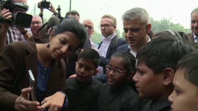 London mayor Sadiq Khan takes part in an air quality science class with Delhi school children using sensors to measure pollution levels around their...