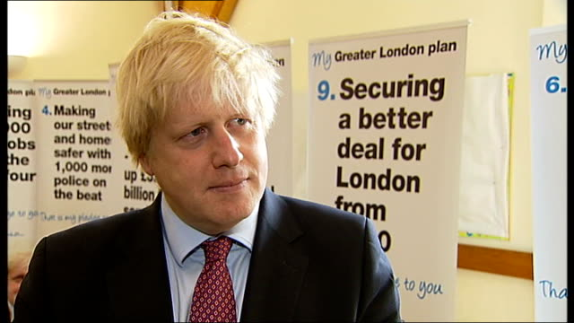 boris johnson promises council tax cuts england west london fulham ext shots of boris johnson crossing road and along into parish hall with others... - charing cross stock videos and b-roll footage
