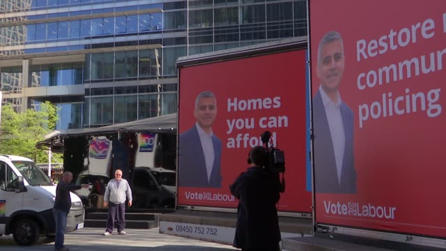 sadiq khan and zac goldsmith interviews england london ext general views labour party campaign posters for sadiq khan / sadiq khan mp along and... - party poster stock videos & royalty-free footage