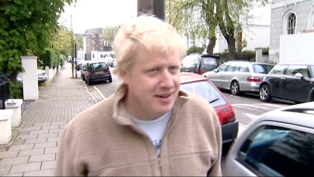 boris johnson on his morning run england london ext boris johnson wearing jogging shorts and fleece out of house and away down road chatting to... - mayor stock videos and b-roll footage