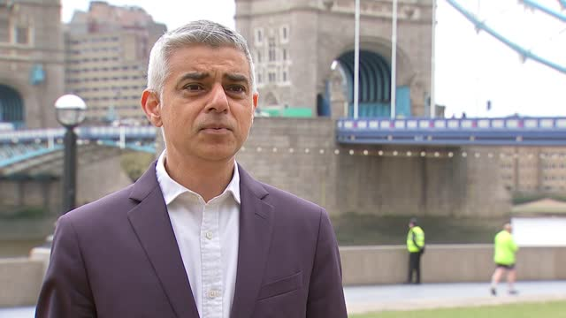 london mayoral election: final week of campaigning; england: london: ext gv shaun bailey standing in front of campaign bus with billboard message 'a... - reptile stock videos & royalty-free footage