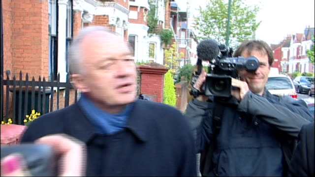 Ken Livingstone travelling to work ENGLAND London EXT Ken Livngstone walking down street surrounded by reporters and photographers as interviewed SOT...