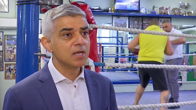 london mayoral election: sadiq khan to explore bringing the olympics back to london if re-elected; uk, london; sadiq khan visiting earlsfield amateur... - distant stock videos & royalty-free footage