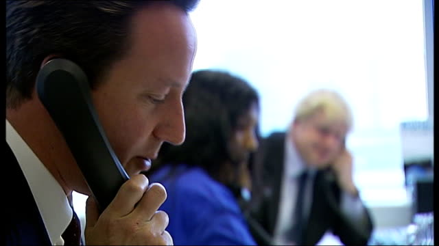 boris johnson campaign visit to london school / at call centre with david cameron westminster various shots of david cameron mp and boris johnson on... - mayor stock videos & royalty-free footage