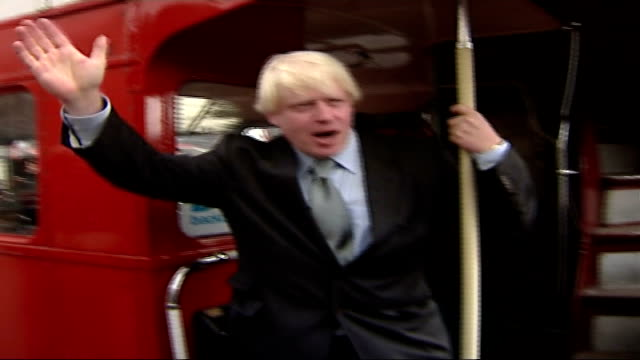 Boris Johnson chosen as Tory candidate EXT Johnson on back of Routemaster doubledecker election battle bus waving as press take photographs and bus...