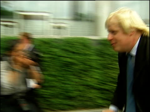 boris johnson to stand johnson along on bicycle past press scrum and away - mayor stock videos & royalty-free footage
