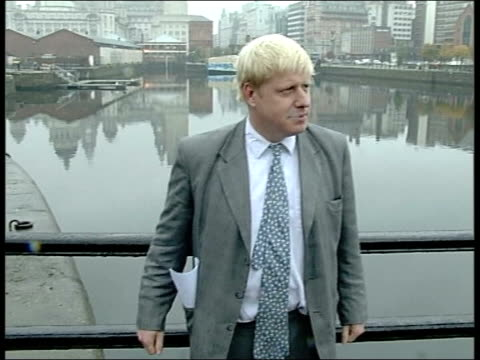 boris johnson to stand liverpool johnson posing for photocall in front of liver building johnson in radio studio ext johnson speaking to liverpudlians - mayor stock videos & royalty-free footage