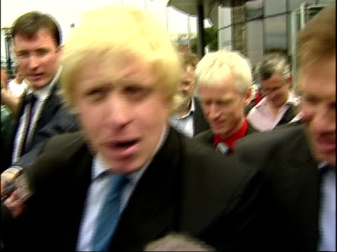 london mayoral elections: boris johnson with bicycle at city hall; england: london: city hall: ext boris johnson mp towards press throng pushing... - wrench stock videos & royalty-free footage