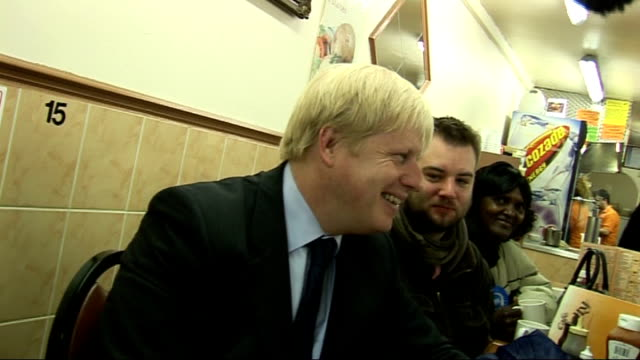 final day boris johnson campaigning int boris johnson seated in cafe as drinking mug of tea and chatting with supporters boris johnson along street... - journalist stock videos & royalty-free footage
