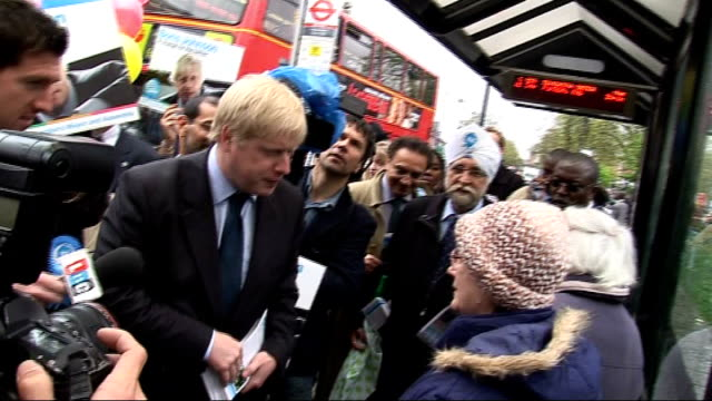 london mayoral elections: last day of campaigning: boris johnson; england: london: ext boris johnson mp along street as campaigning, talking to... - mp stock-videos und b-roll-filmmaterial