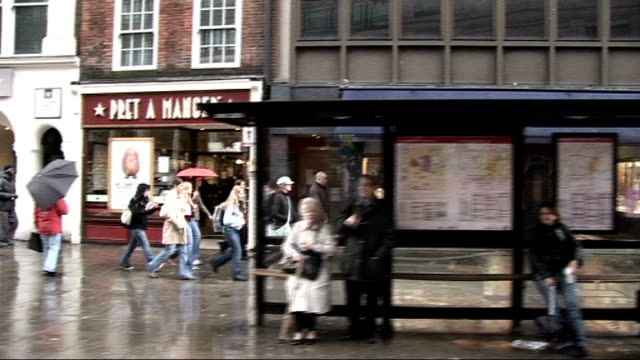 last day of campaigning boris johnson ext rainy high street and shoppers seen from moving bus/ 'boris johnson' poster on back of bus as along - last day stock videos & royalty-free footage