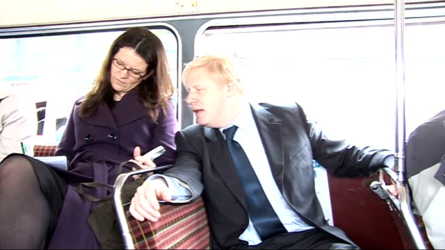 last day of campaigning boris johnson int johnson seated on routemaster bus as along chatting to journalists - last day stock videos & royalty-free footage
