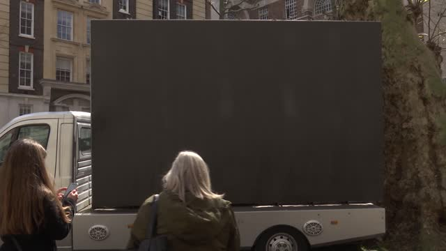 london mayoral elections: sadiq khan billboard launch and interview; england: london: smith square: ext various of mobile billboard showing image of... - politics video stock e b–roll