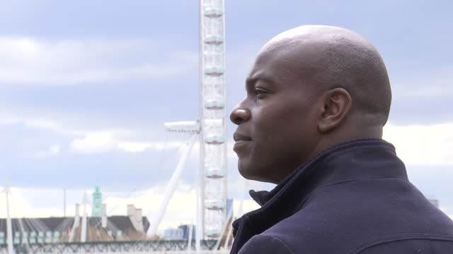london mayoral elections: shaun bailey interview; england: london: ext various shaun bailey set-up shots standing looking out over river thames. - politics video stock e b–roll