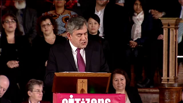 methodist central hall: int audience members standing, applauding and cheering as gordon brown arrives at citizens uk event sot brown waving and... - gordon brown stock-videos und b-roll-filmmaterial
