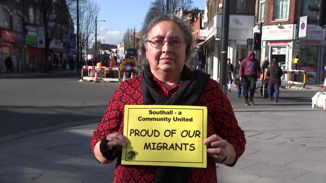 London migrants protest against rising hate crime since Brexit vote Southall People along in street Various shots local people from Punjabi community...