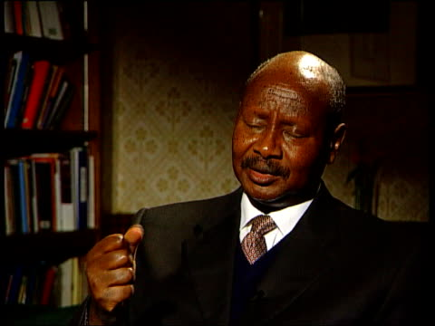 london millbank int yoweri museveni interview sot there are so many groups evangelical groups offshoots / the groups we closed down were defiling... - selbstmord stock-videos und b-roll-filmmaterial