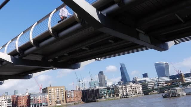 london millennium bridge and the city skyline - london millennium footbridge stock videos and b-roll footage