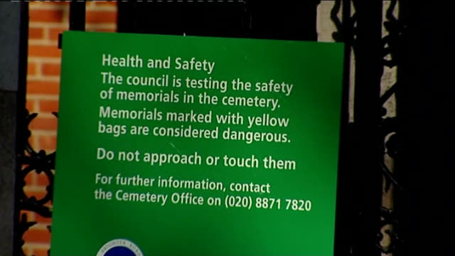 london morden ext morden cemetery sign health and safety sign attached to cemetery gates saying 'council is testing the safety of memorials' hearse... - pompe funebri video stock e b–roll