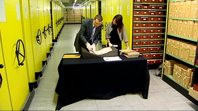 national archives curator showing reporter released government documents from 1980 - curator stock videos & royalty-free footage