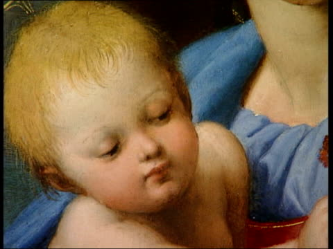 london national gallery overlay classical music madonna and child painting by raphael on gallery wall woman up to painting and looks at it detail of... - raphaël haroche stock videos & royalty-free footage