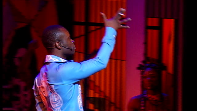 London National Theatre INT Various shots cast of Fela performed on stage singing dancing band playing SOT Sahr Ngaujah performing on stage PULL...