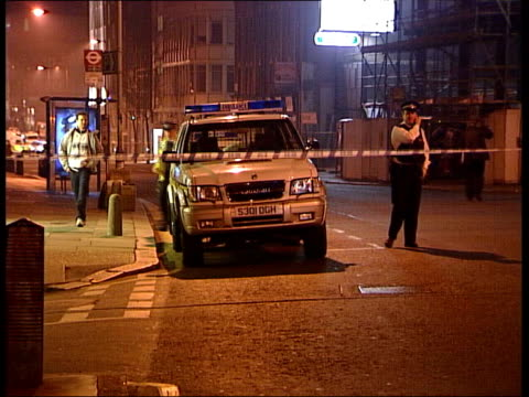 nightclub shooting itn england london clerkenwell police on duty in cordonnedoff road outside turnmills club ms officers about by police car pull - islington stock-videos und b-roll-filmmaterial