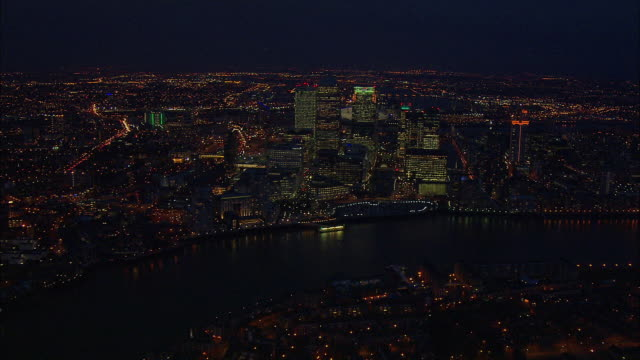 London night-time aerial along River Thames, Canary Wharf, O2 Arena and Excel Centre