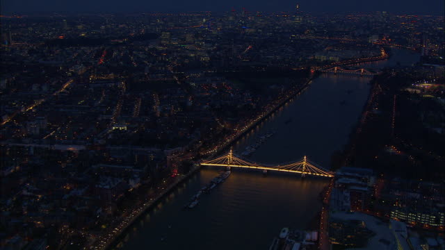 london night-time aerial along river thames from battersea to westminster - battersea stock videos & royalty-free footage