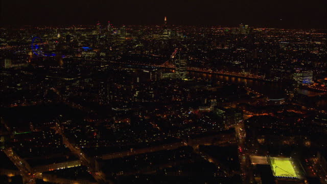 London night-time aerial along River Thames from Chelsea Bridge to Tower Bridge