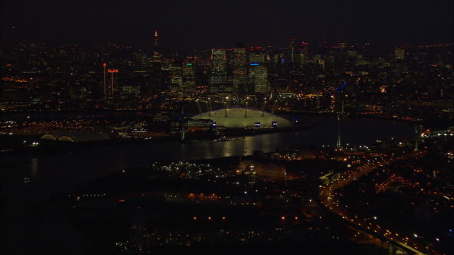 london night-time aerial o2 arena to canary wharf - the o2 england stock videos & royalty-free footage