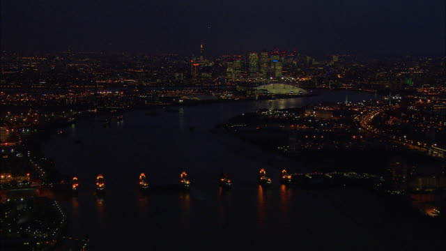 london night-time aerial thames barrier and o2 arena with canary wharf and thames barrier - the o2 england stock videos & royalty-free footage