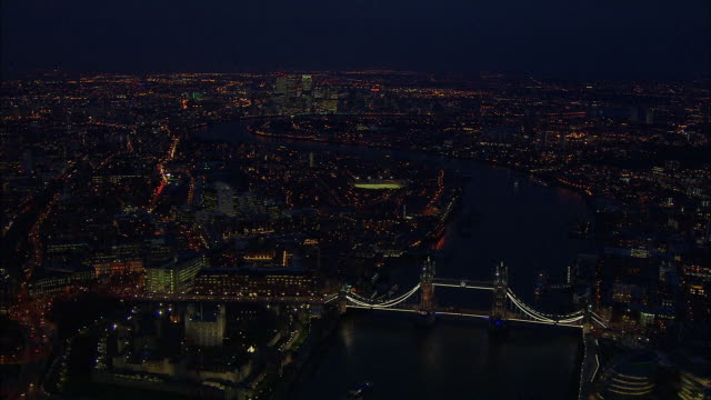 london night-time aerial tower bridge to canary wharf along river thames - river thames stock videos & royalty-free footage