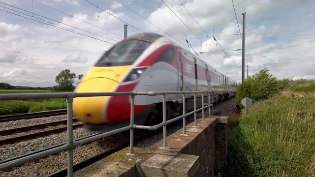 lner london north eastern railway azuma passenger train heading south on the east coast mainline in cambridgeshire england. - rail transportation stock videos & royalty-free footage