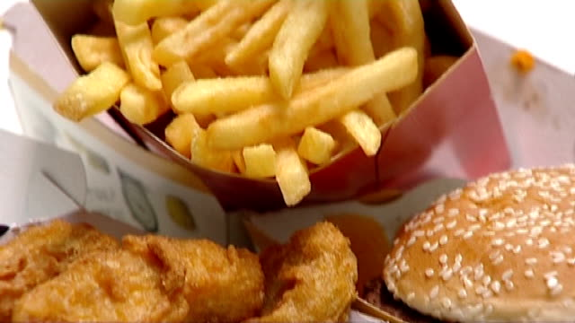 london 'obesity emergency' takeaways should be banned from walking distance of schools r18021310 / london int mcdonalds quarter pounder burger fries... - quarter stock-videos und b-roll-filmmaterial