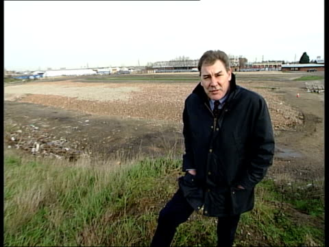 London Olympic bid submitted ITN London BV London cabbie driving Shoe stepping on rocky ground at disused Hackney Dog Track at Hackney Marshes i/c...