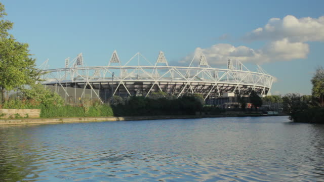 ws tu london olympic stadium and river lea in stratford east london / london, uk - film tilt stock videos and b-roll footage