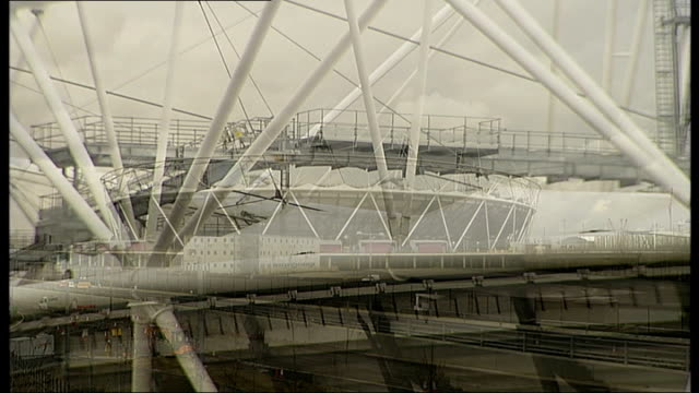 future plans ENGLAND London Stratford Olympic Stadium EXT Close Shots of floodlights and metal girders of Olympic stadium Long GV Stadium Neale...