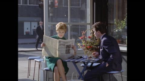 stockvideo's en b-roll-footage met 1961 - london - outdoor cafe - rubriekadvertentie