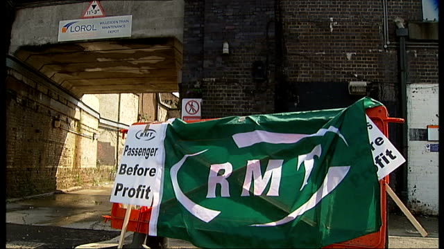 london overground guards stage strike action over threat of job cuts; england: london: ext various of members of the rmt union who work on london... - strike industrial action stock videos & royalty-free footage