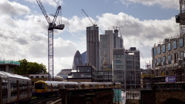 london overground trains and city of london skyscrapers from the north - land vehicle stock videos & royalty-free footage